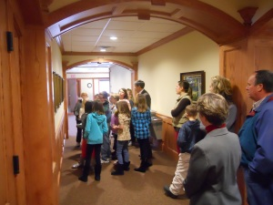 HCS 4th Grade Visit - Looking at former professor pictures in hallway