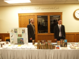 Seminary students Brian Feenstra and Nathan Price help at the Seminary display tables