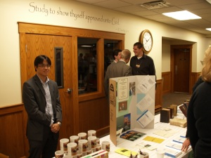 Aaron Lim helps staff the Seminary display table