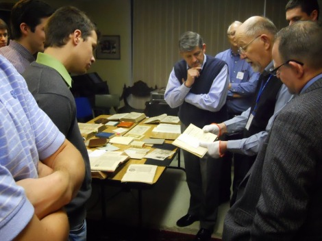 Dr.R.Klein showing the group some rare German Reformation items.