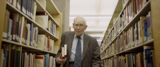 Puritan scholar J. I. Packer strolling the stacks at the John Allen Library in Vancouver.